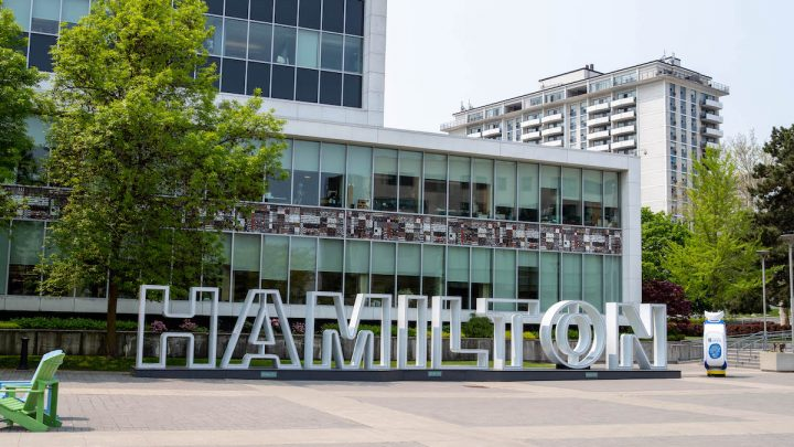 A shot of the large structure spelling out Hamilton in the city