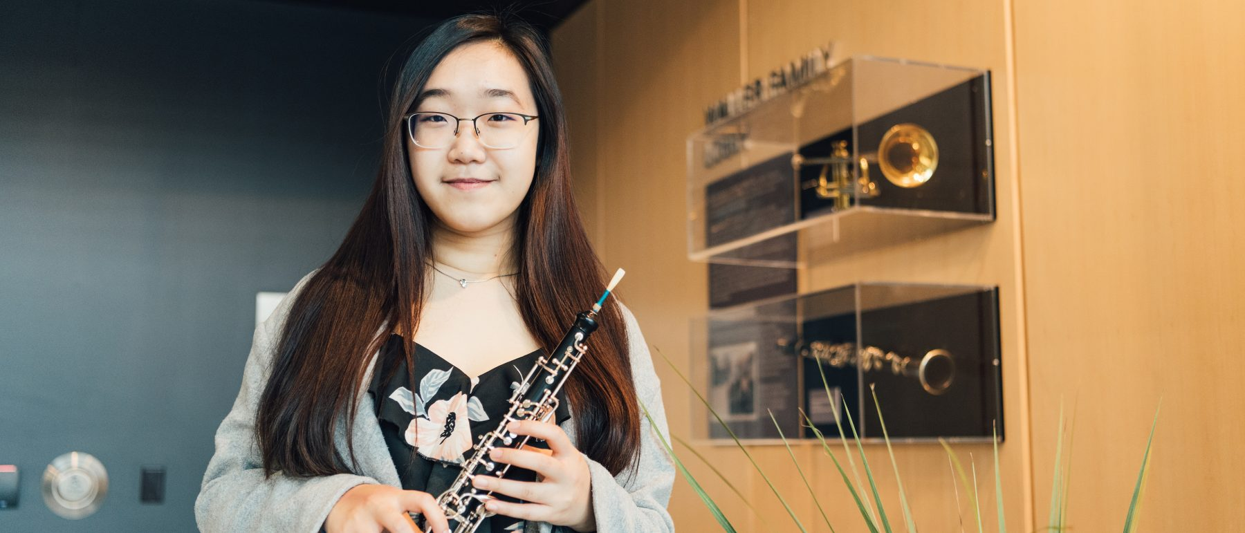 A student standing for a picture with a flute