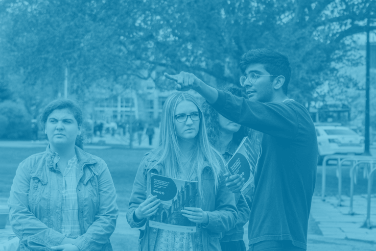 A blue duotone image of a McMaster University student giving directions to three campus visitors