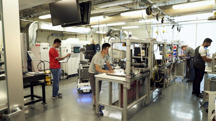 Students working in the learning factory