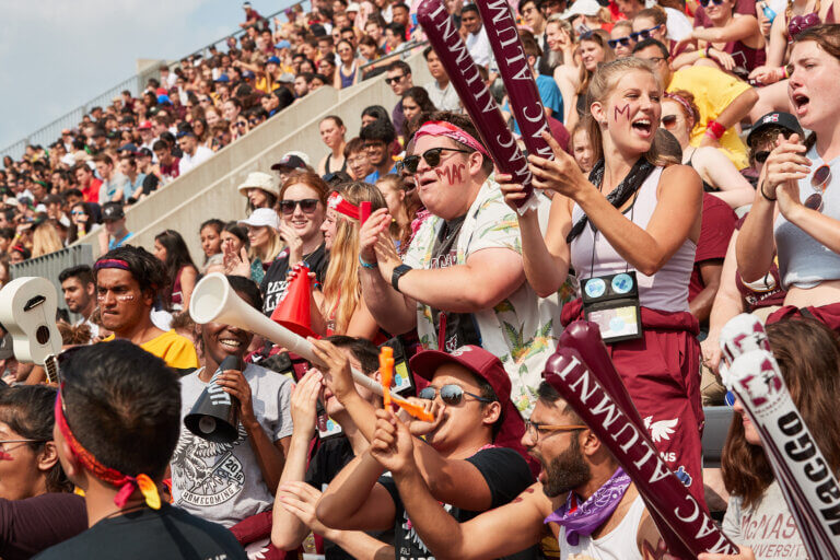 Image of McMaster students cheering in the bleachers
